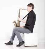 Saxophonist in shirt playing melody Royalty Free Stock Photography