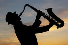 Saxophonist at sunset Stock Photos
