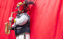 Saxophonist takes part in the Carnival parade of troupes at Bada Stock Photo