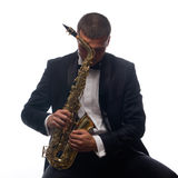Saxophonist in tuxedo Royalty Free Stock Photos