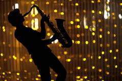 Saxophonist. Woman playing on saxophon Stock Photos