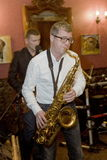 saxophoniste, cocktail de groupe de bruit de musicien, Alexander Mazurov Images stock