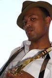 Saxophoniste de jeunes de gratte-cul Photos stock