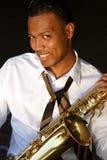 Saxophoniste de jeunes de gratte-cul Photo libre de droits