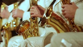 Saxophonists in white suits play a jazz part. Small DOF. Saxophonists in white suits play a jazz part. Close-up stock footage