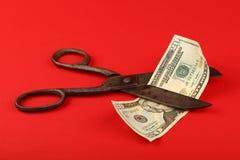 SaxsnittUS dollar över röd bakgrund Arkivbilder