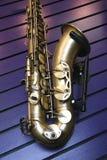 Saxy. Saxophone ( musical instrument ) resting on it's rack Stock Photos