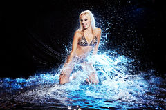 Saxy woman dancing in water on black , Stock Photo