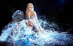 Saxy woman dancing in water on black , Royalty Free Stock Photography