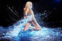 Saxy woman dancing in water on black , Stock Photos