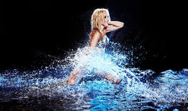 Saxy woman dancing in water on black , Royalty Free Stock Image