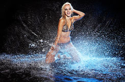 Saxy woman dancing in water on black , Stock Photography