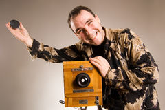 Say cheese. Man dressed khaki shooting with ald camera Royalty Free Stock Photo