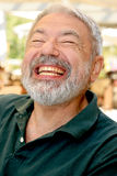 Say cheese. Vital senior man with gray beard grinning Stock Photo