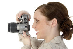 Say Cheese. Woman with digital slr camera Royalty Free Stock Images