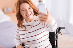 Alert incapacitated woman taking pictures Stock Photography
