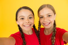 Say cheese. Child girls taking photo. Children kids happy faces. Video call concept. Video conference camera. Girls long. Hair taking selfie. Selfie for social royalty free stock images