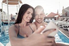 Happy millennial couple taking selfies outdoors stock photos