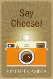 Say Cheese poster. Retro photographic poster with the slogan Say Cheese!, on crumpled brown paper background Stock Images