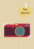 Say cheese. Retro camera with say cheese text on background Royalty Free Stock Image