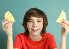 Say cheese smile preteen boy with two cheese slices Stock Photography