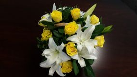 Basket of Yellow Roses and White Lilies - power of flowers Royalty Free Stock Photo