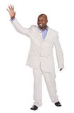 Say goodbye. Happy african american businessman saying goodbye royalty free stock photography