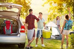 Say hello to just arrived friends on a camping trip. Young people say hello to just arrived friends on a camping trip stock photography