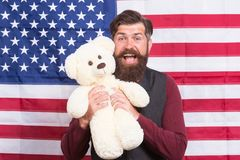 Say it loud for country proud, happy Independence day. Bearded man holding teddy bear on Independence day. Happy hipster stock photos