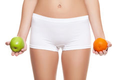 Say no to cellulitis. Woman holding an orange and apple without signs of cellulitis stock image