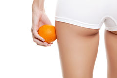 Say no to cellulitis. Woman with an orange showing a perfect skin without cellulitis Stock Photos