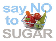 Say NO to SUGAR. Mini shopping basket containing a pear, carrot, red pepper, tomato and sprouts with the words say NO to SUGAR around the sides on a white Royalty Free Stock Photos