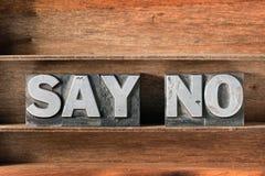 Say no tray. Say no phrase made from metallic letterpress type on wooden tray Royalty Free Stock Photo