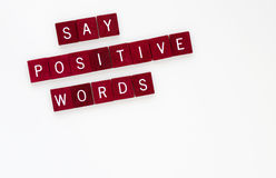 Say Positive Words, Horizontal. Dark wooden tiles with words, Say Positive Words isolated on horizontal, white background royalty free stock photos