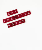 Say Positive Words, Vertical. Dark wooden tiles with words, Say Positive Words isolated on vertical, white background royalty free stock image