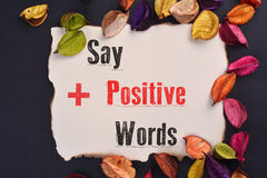 Say Positive Words. Writing Say Positive Words on paper stock images