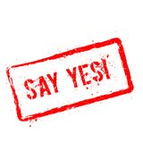 Say Yes!. Red rubber stamp isolated on white. Say Yes!. Red rubber stamp isolated on white background. Grunge rectangular seal with text, ink texture and Royalty Free Stock Photography