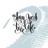 Say yes to life hand lettering inscription. Motivation and inspiration love and life positive quote, calligraphy vector illustration on blue brush stroke Royalty Free Stock Image