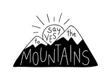Say Yes to the Mountains. Mountain silhouette with sun, contains hand drawn text. Royalty Free Stock Photo