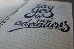 Say Yes to New Adventures calligraphic background Royalty Free Stock Images