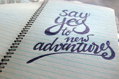Say Yes to New Adventures calligraphic background Stock Image