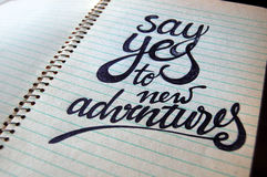 Say Yes to New Adventures calligraphic background. For your design stock images