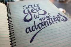 Say Yes to New Adventures calligraphic background. For your design royalty free stock photography