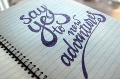 Say Yes to New Adventures calligraphic background Stock Photo