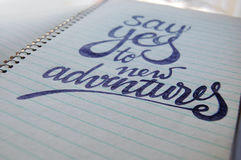 Say Yes to New Adventures calligraphic background Stock Images