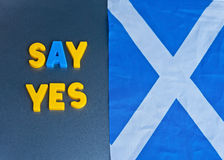Say yes to Scottish Independence. Text saying ' say yes ' in colorful uppercase letters next to the Scottish flag, the Saltire and refers to the planned Royalty Free Stock Images