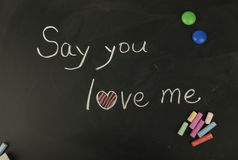 Say you love me. Written on blackboard with chalk Royalty Free Stock Photos