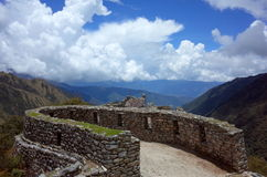 The Sayacmarca ruins on the Inca Trail. The lookout post of the Sayacmarca ruins on the Inca Trail looking out onto the mountains in the distance Royalty Free Stock Image