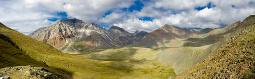 Sayan Mountains. Panorama from the peak to the plateau in the Sayan Mountains Royalty Free Stock Image