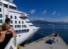 Saying bon voyage. Couple waiting to see cruise ship off Stock Image